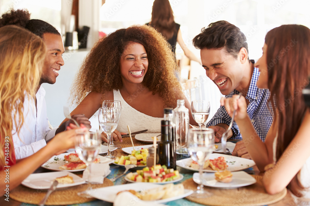Fototapety, obrazy: Group Of Young Friends Enjoying Meal In Outdoor Restaurant