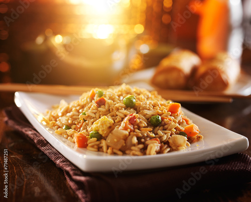 chinese fried rice on plate with orange glow Wallpaper Mural