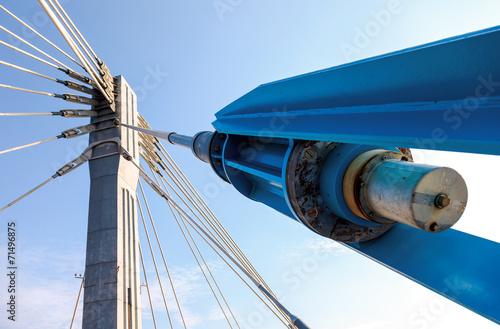 Fototapeta Modern cable bridge pylon against blue sky obraz