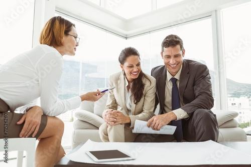 Fototapety, obrazy: Couple talking to female architect