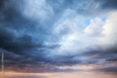 Fotografering  Dark blue stormy cloudy sky. Natural photo background