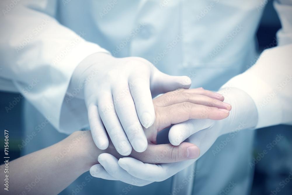 Fototapeta Hands of the doctor and patient