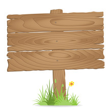 Wooden Signpost On  Grass With...