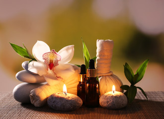 Obraz na PlexiSpa composition with herbal massage bags, candles and bamboo