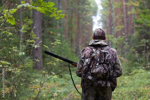 Aluminium Prints Hunting hunter in the forest