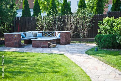 Slika na platnu Место для отдыха в саду / Rest place in the garden
