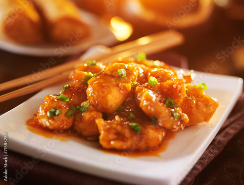 Photo  plate of chinese sesame chicken take out