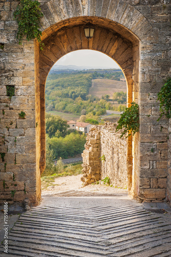 Fototapeta Exit the town of Monteriggioni with views of the Tuscan landscap obraz