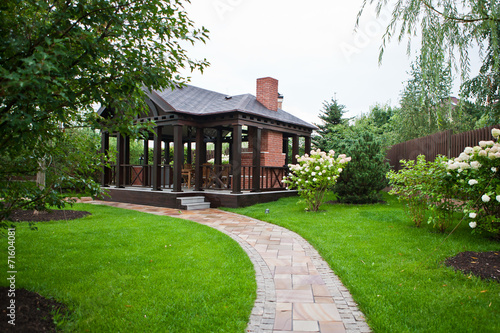 Fotobehang Tuin Патио в саду / Garden patio