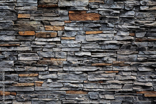 Old brick wall from a stone Canvas Print