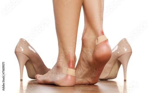 Obraz na płótnie Closeup of a woman's heel with a blister plaster on