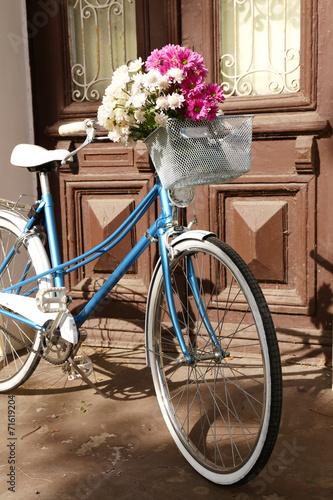Foto op Plexiglas Old bicycle with flowers in metal basket
