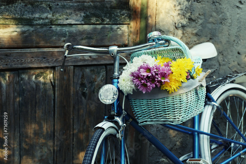 Photo Stands Bicycle Old bicycle with flowers in metal basket