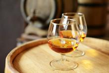 Glasses Of Brandy In Cellar Wi...
