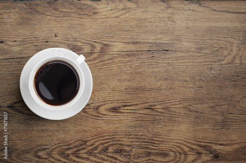 Black coffee cup on old wooden table top view