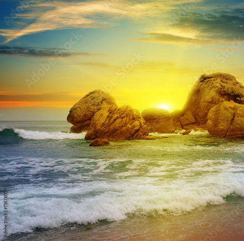 Poster Geel sea landscape with rocky island and the sunrise