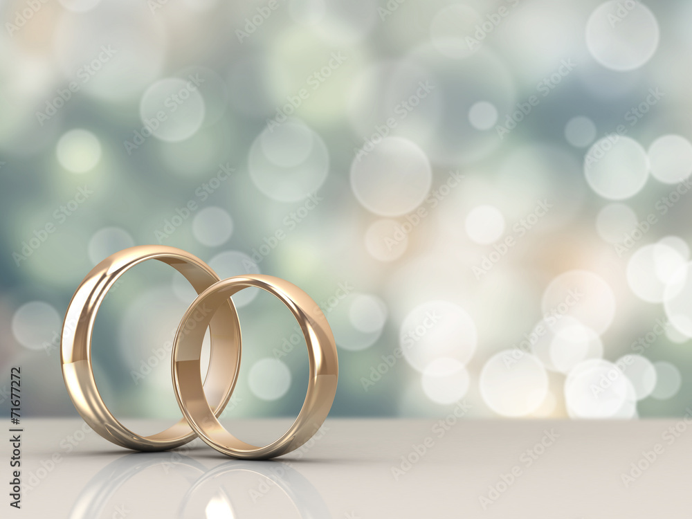 Fototapety, obrazy: A pair of gold wedding rings with bokeh background
