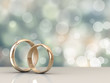 canvas print picture - A pair of gold wedding rings with bokeh background