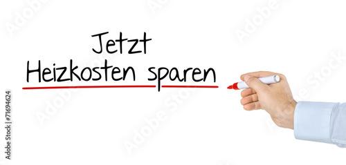 Hand Mit Stift Schreibt Jetzt Heizkosten Sparen Buy This Stock