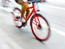 Woman On Red Bike
