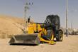 Yellow tractor - dozer - pitchfork