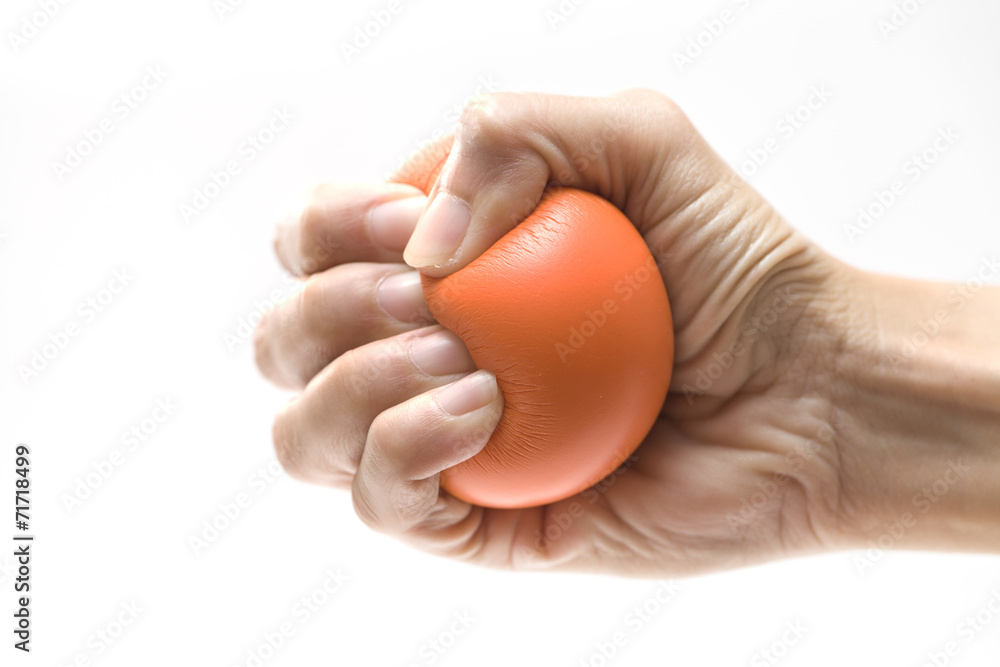 Fototapeta Hand squeezing a stress ball