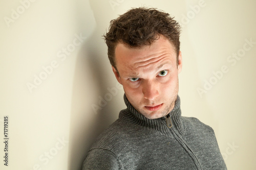 Photo  Closeup portrait of young sarcastic Caucasian man