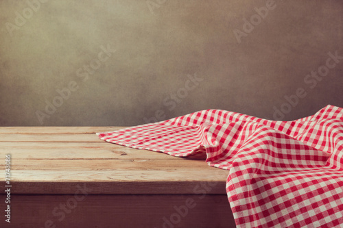 Fototapeta Empty wooden deck table with checked tablecloth obraz