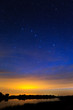 Morning dawn on a starry background sky reflected in the water o