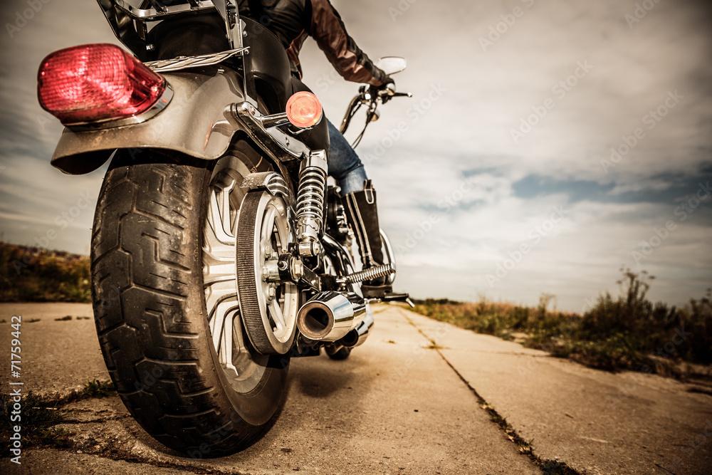 Fototapeta Biker girl riding on a motorcycle