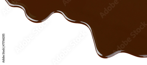 Melted chocolate dripping on white background Canvas-taulu