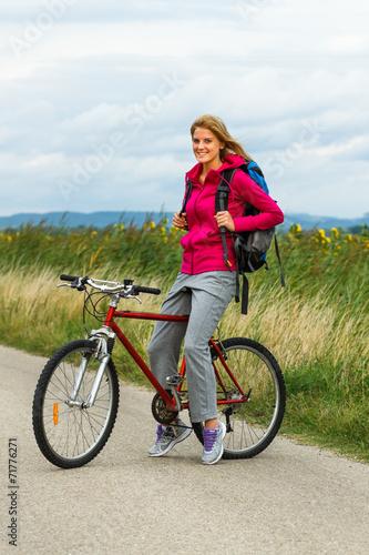 Fototapeta Happy woman with a bike obraz na płótnie