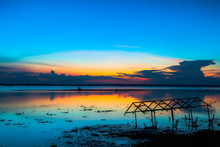 Sunset Sky Over Lake Or River And Home With Flood At Twilight