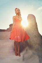 Lady In Red Dress In An Unusual Landscape