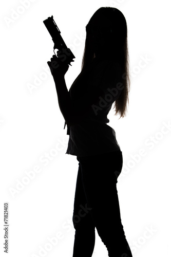 Silhouette of young woman with gun плакат