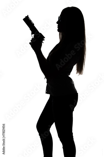 фотография  Silhouette of young sexy woman with gun