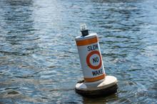A No Wake Zone Buoy In A River