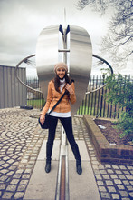 Smiling Woman Straddling The Prime Meridian Line