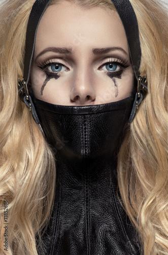 Photo  Portrait of blonde woman in BDSM neck collar