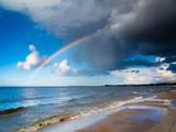 Fototapeta Tęcza - landscape view on sky with rainbow at sea.