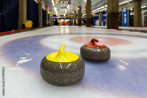 Leinwand Poster Curling stones on an indoor rink