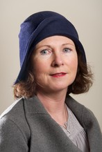 Brunette In Blue Cloche Hat And Jacket