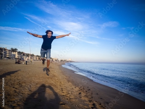 Fototapety, obrazy: man jumping on the beach