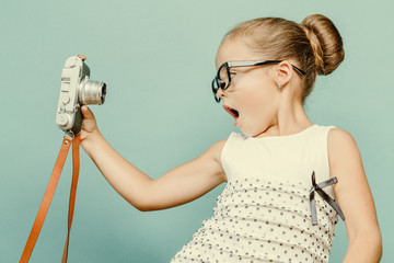 Fototapeta child holding a instant camera