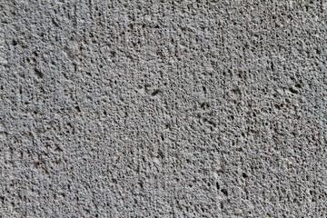 Fototapeta Nahaufnahme einer groben, dunkelgrauen Betonwand