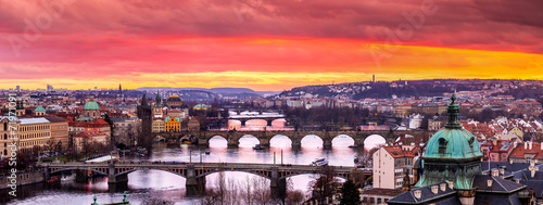 Photo Stands Lavender Bridges in Prague over the river at sunset