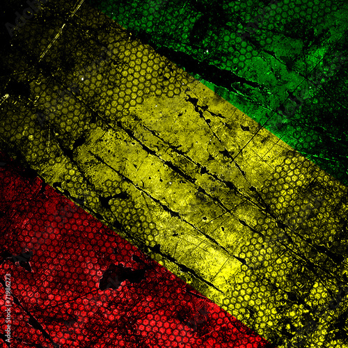 Red, yellow, green rasta flag on grunge textured concrete wall Canvas-taulu
