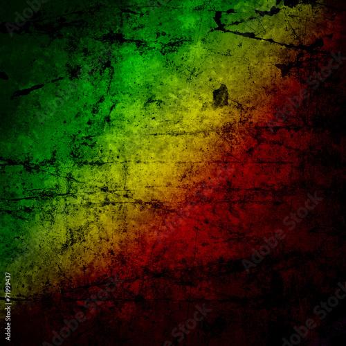 Fotografie, Obraz  Red, yellow, green rasta flag on grunge textured concrete  wall