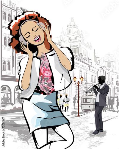 mody-dziewczyna-slucha-muzyka-w-miasto-ulicie