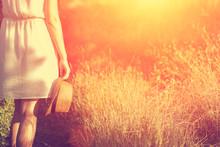 Woman Walking In Summer Sunset